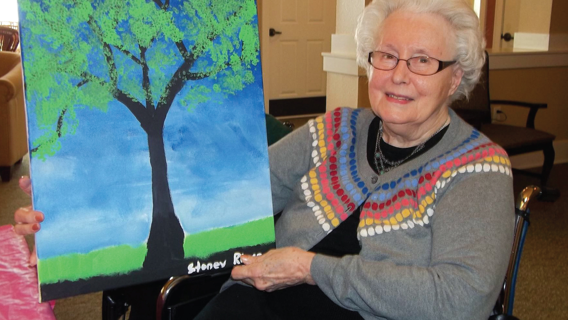 woman with her tree painting
